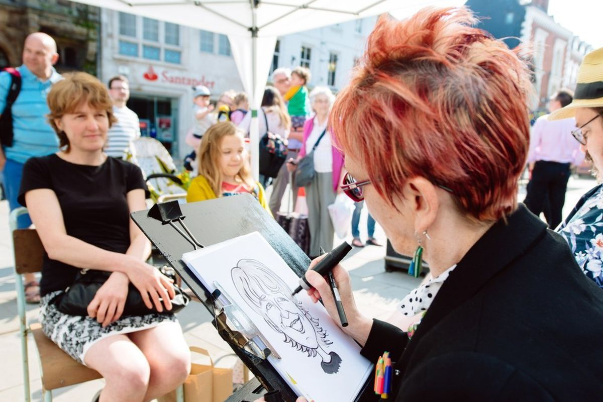 Chris Ryder creating caricatures at last year's Cartoon Festival