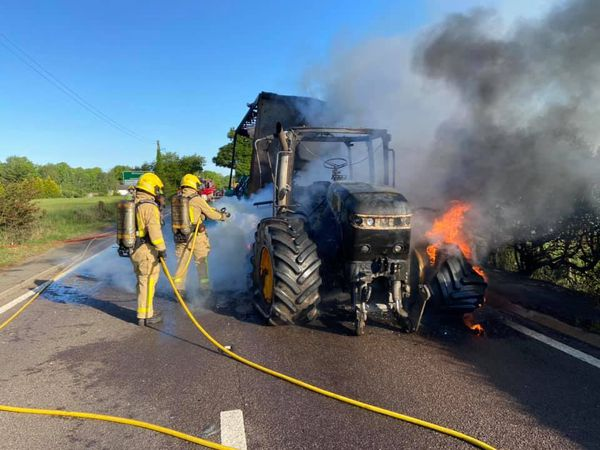 Firefighters fight the tractor blaze on the A41. Photo: Market Drayton Fire Station