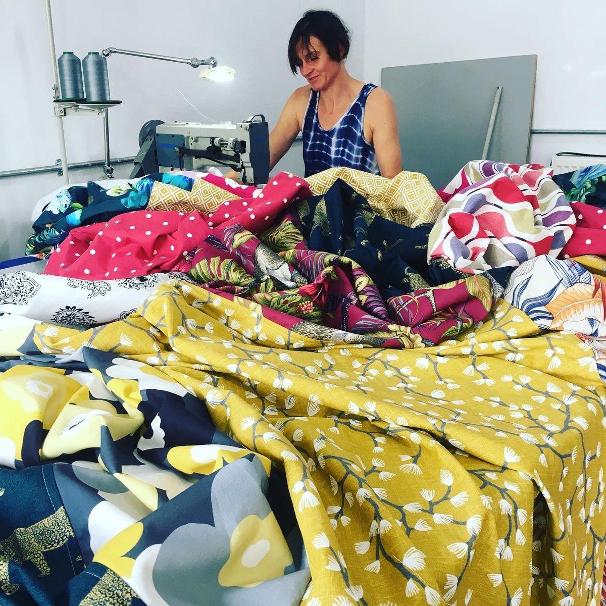 Emma Williams stitches fabric squares together