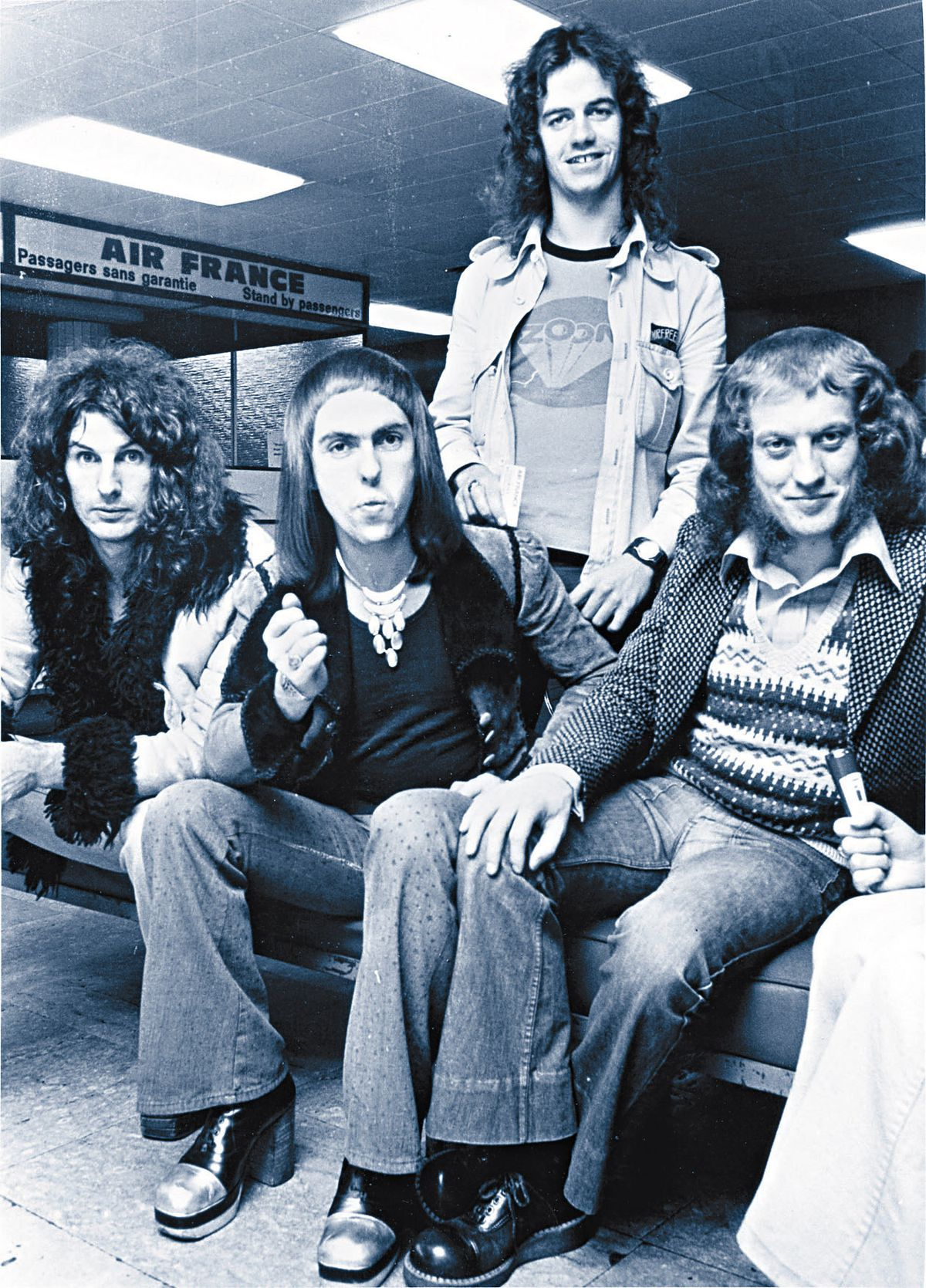 Slade at Heathrow airport, in 1972: Don Powell, Dave Hill, Jim Lea and Noddy Holder. Picture: Barry Plummer