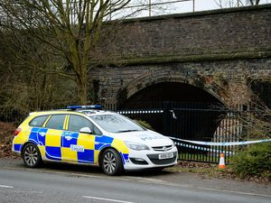 Police at the scene in Old Potts Way, Shrewsbury.