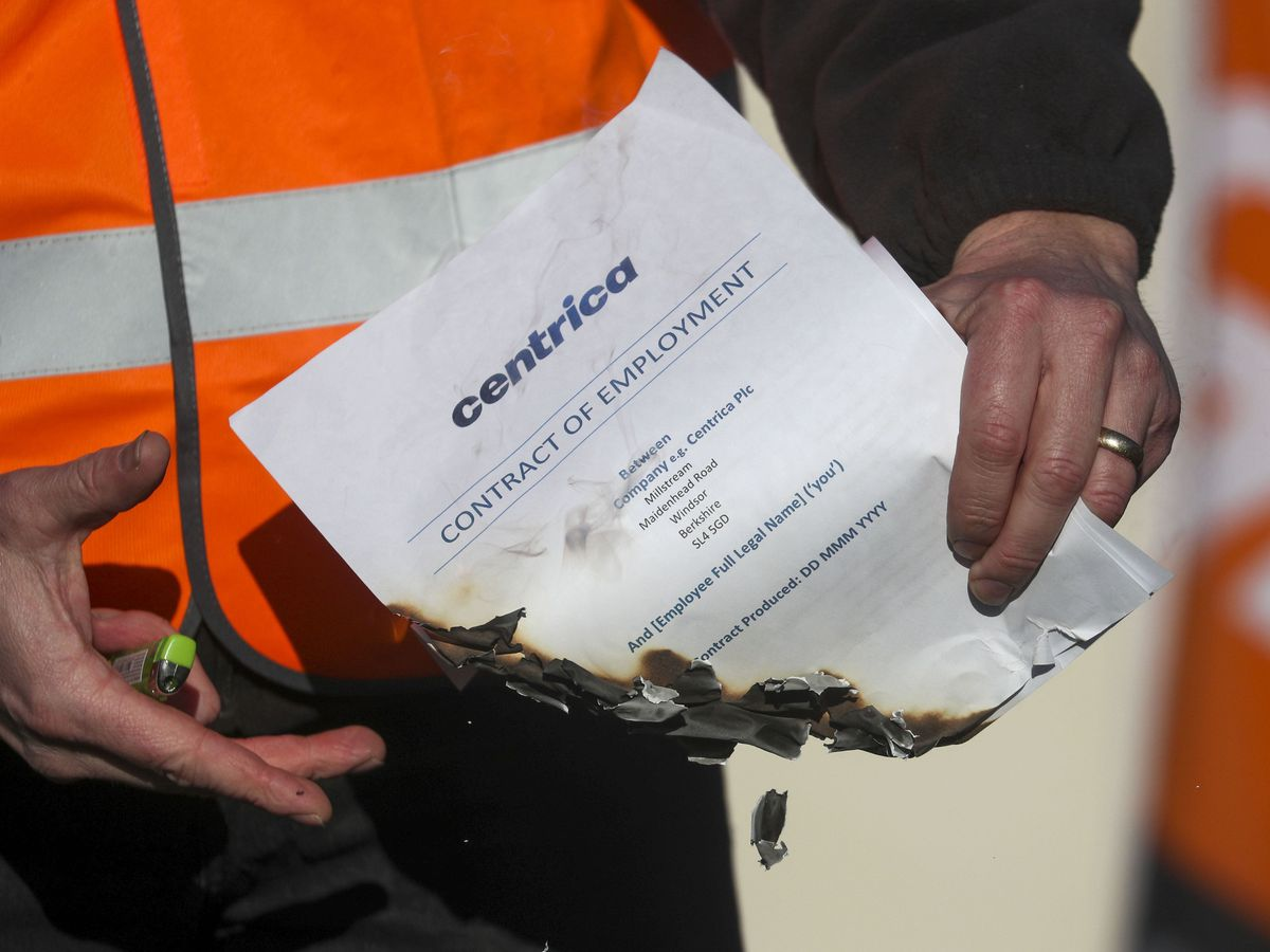 A British Gas worker burns a contract outside Centrica's HQ