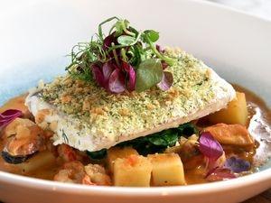 Herb crusted hake steak with seafood stew