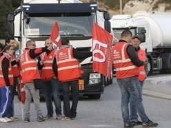 French truckers stage blockades over labour reforms