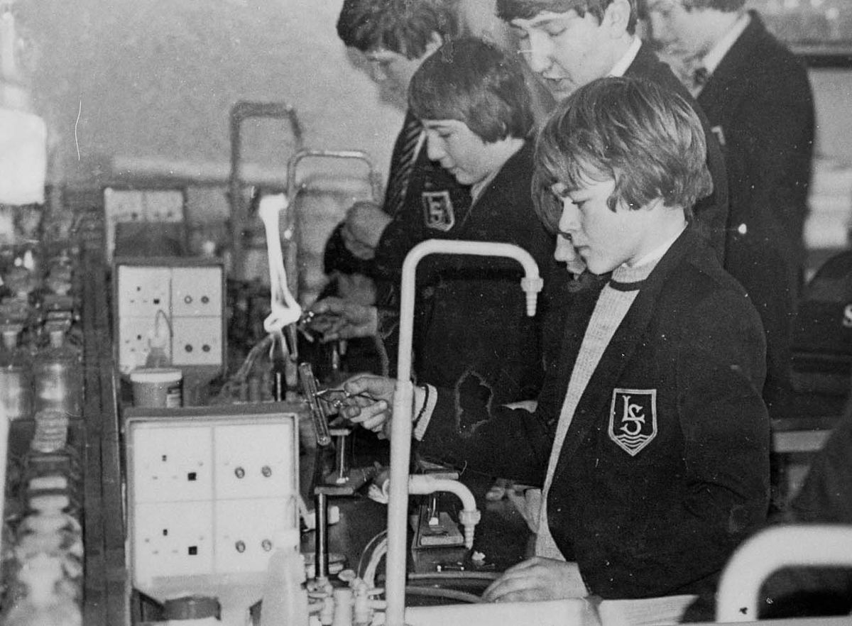 The appliance of science. Concentration is etched on the faces of pupils at the Lakelands School at Ellesmere in a science lesson in 1985. What are they learning? And is that a flame coming from above the test tube?