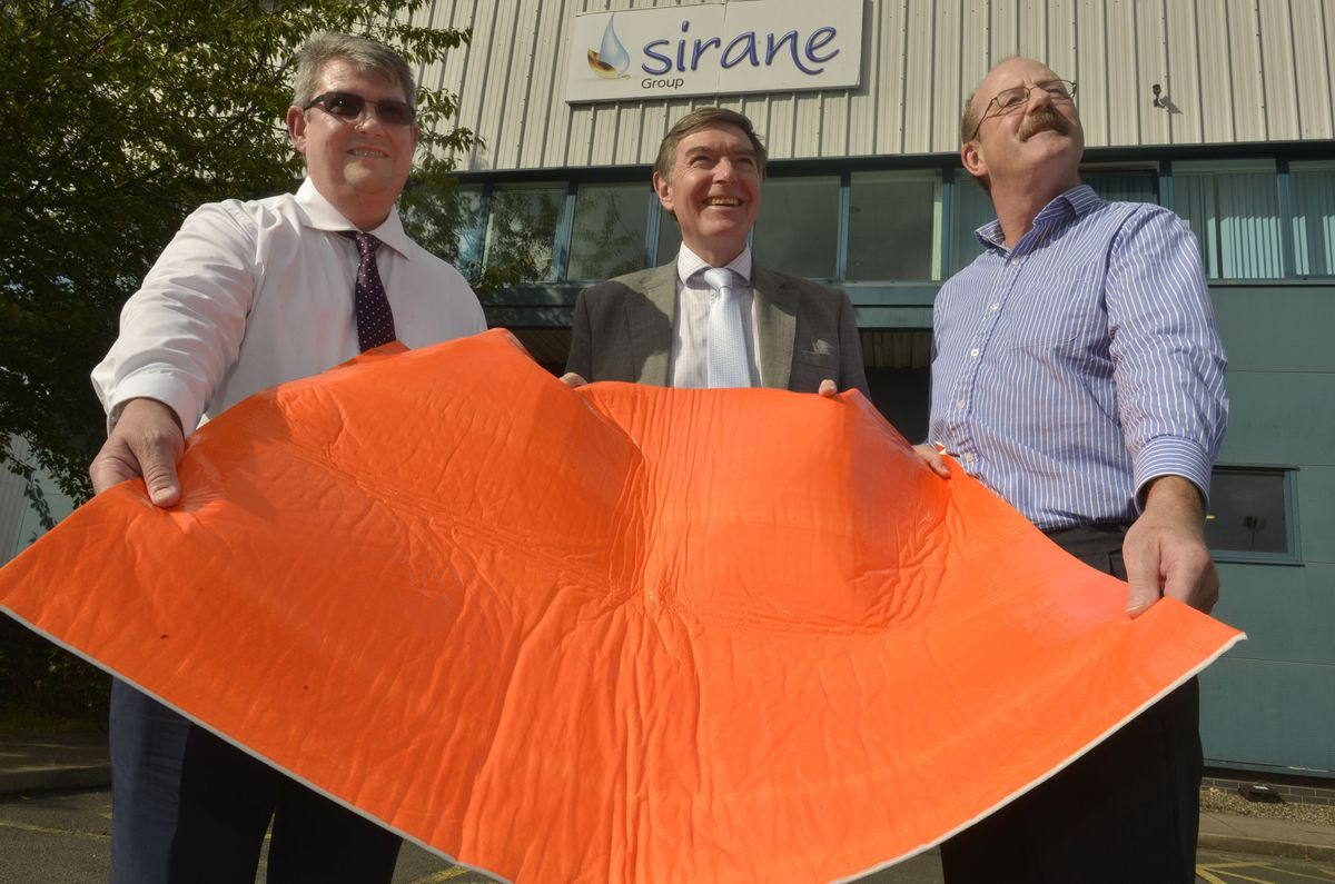 MP Philip Dunne, centre, came to see with sales director Jeremy Haydn-Davies and managing director Simon Balderson to discuss Sirane's high tech floor mats