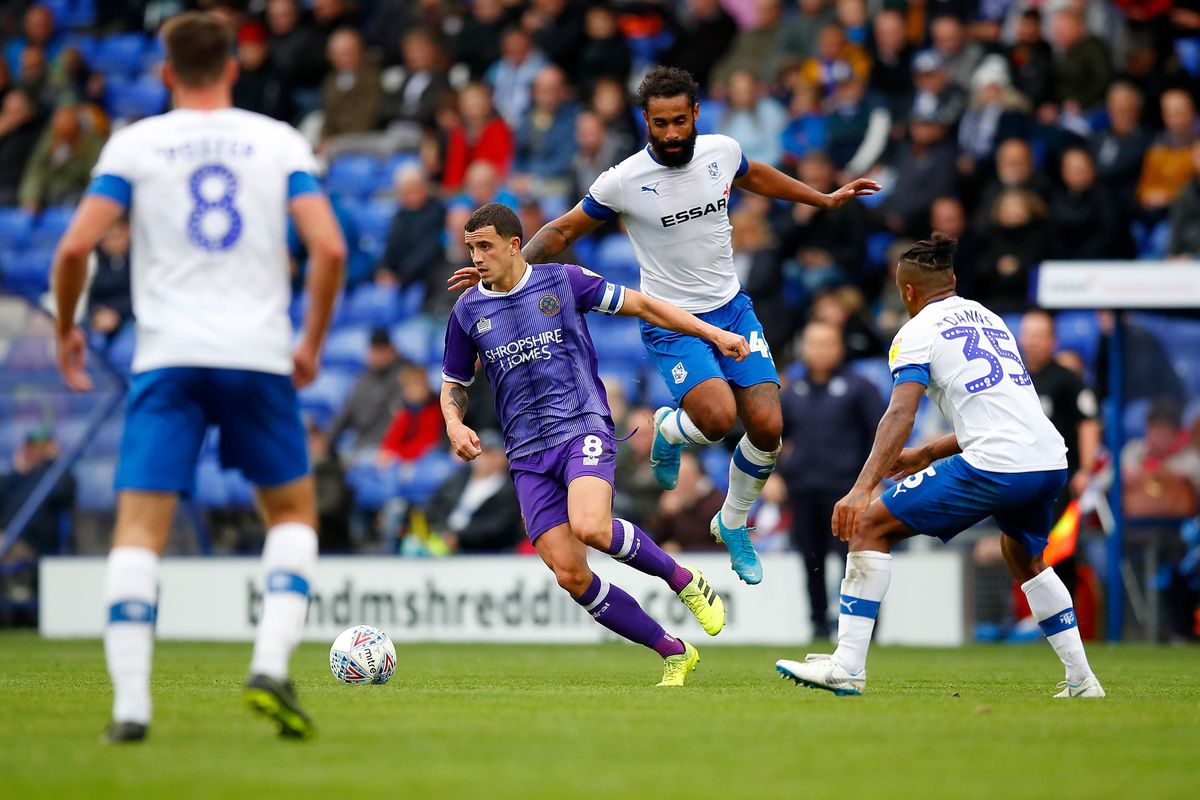 Stefan Payne of Tranmere Rovers challenges Oliver Norburn of Shrewsbury Town. (AMA)