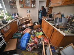 In Pictures: Residents survey damage after Storm Dennis hits UK