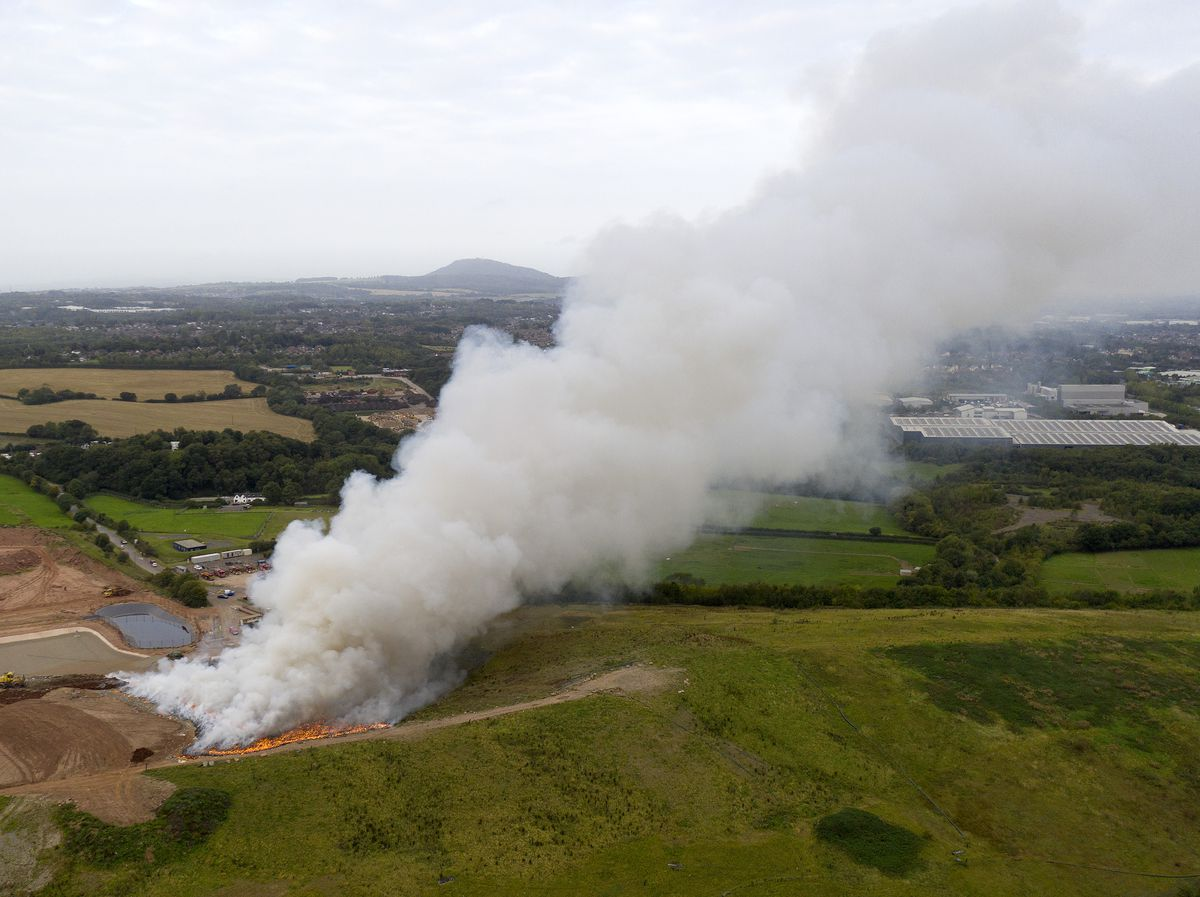 Smoke rising from the site. Photo © Sam Bagnall