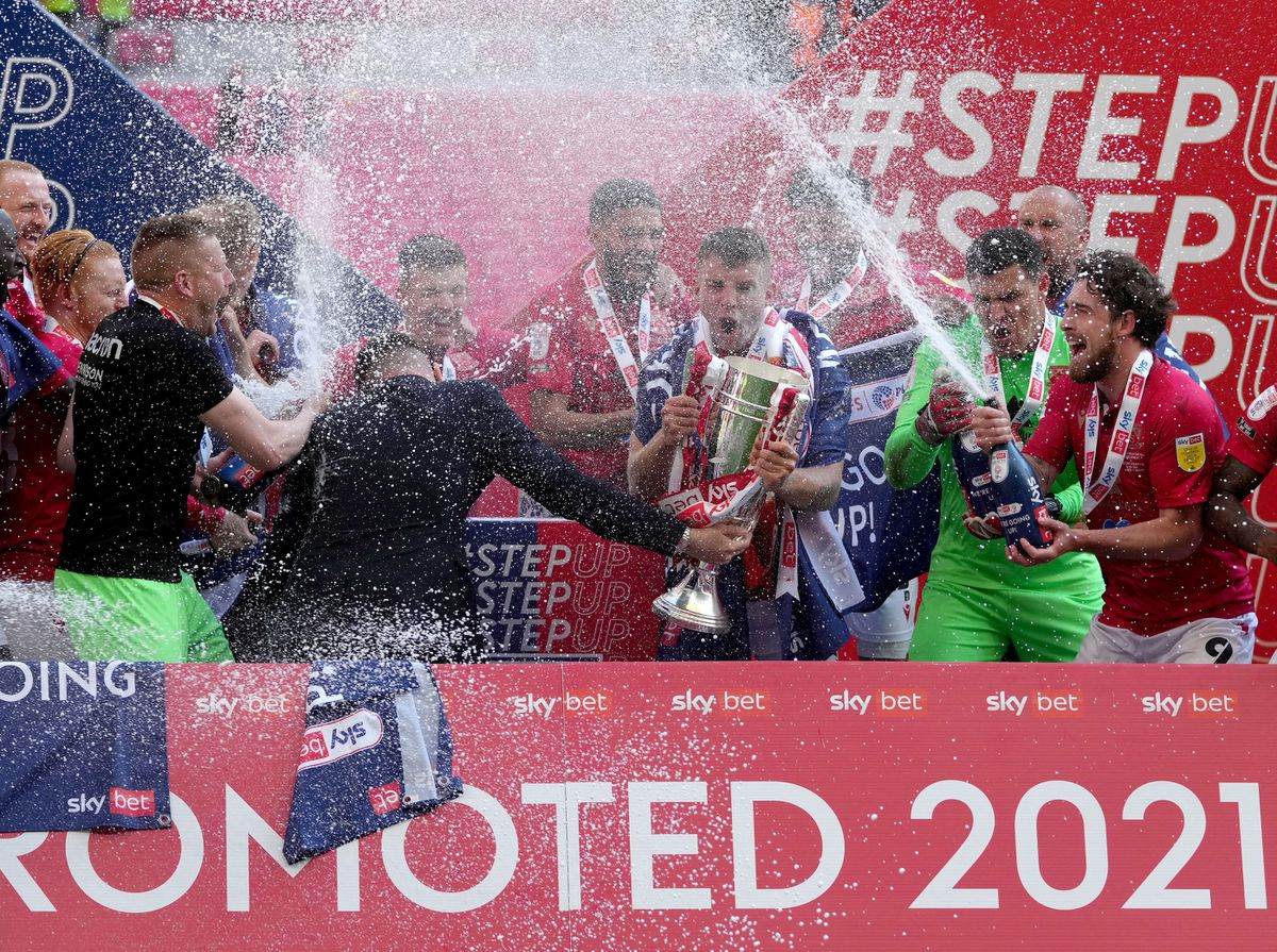 Morecambe players celebrate with the trophy