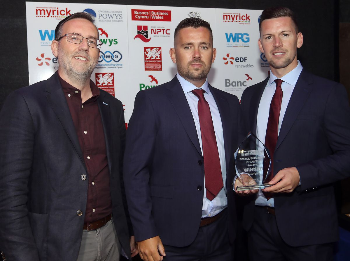 Scott and Luke Williams from Team Elite receive the Small Business Growth Award from Nick Venti, representing EDF Renewables, sponsor.Picture by Phil Blagg Photography.