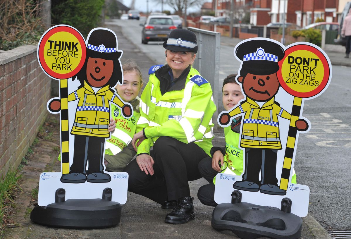 With the new mini officers at Oak Meadow School, Bayston Hill, are Keira Price and Henry Knipp and PCSO Lyn Birch