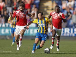 Shaun Whalley of Shrewsbury Town and Luke Murphy of Crewe Alexandra. (AMA)