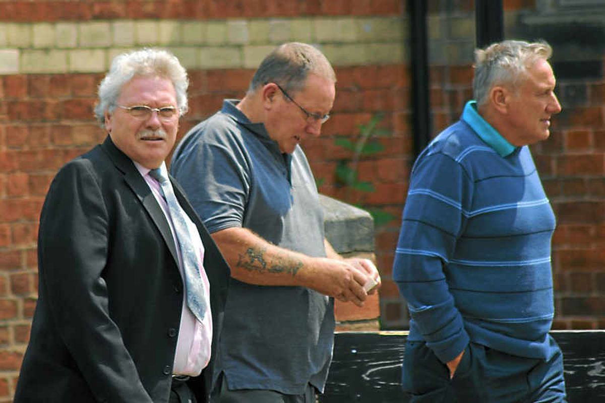 Robert Purcell, on the left wearing a black jacket, looks at the camera near Shrewsbury Crown Court. Picture: Ceri Saunders.