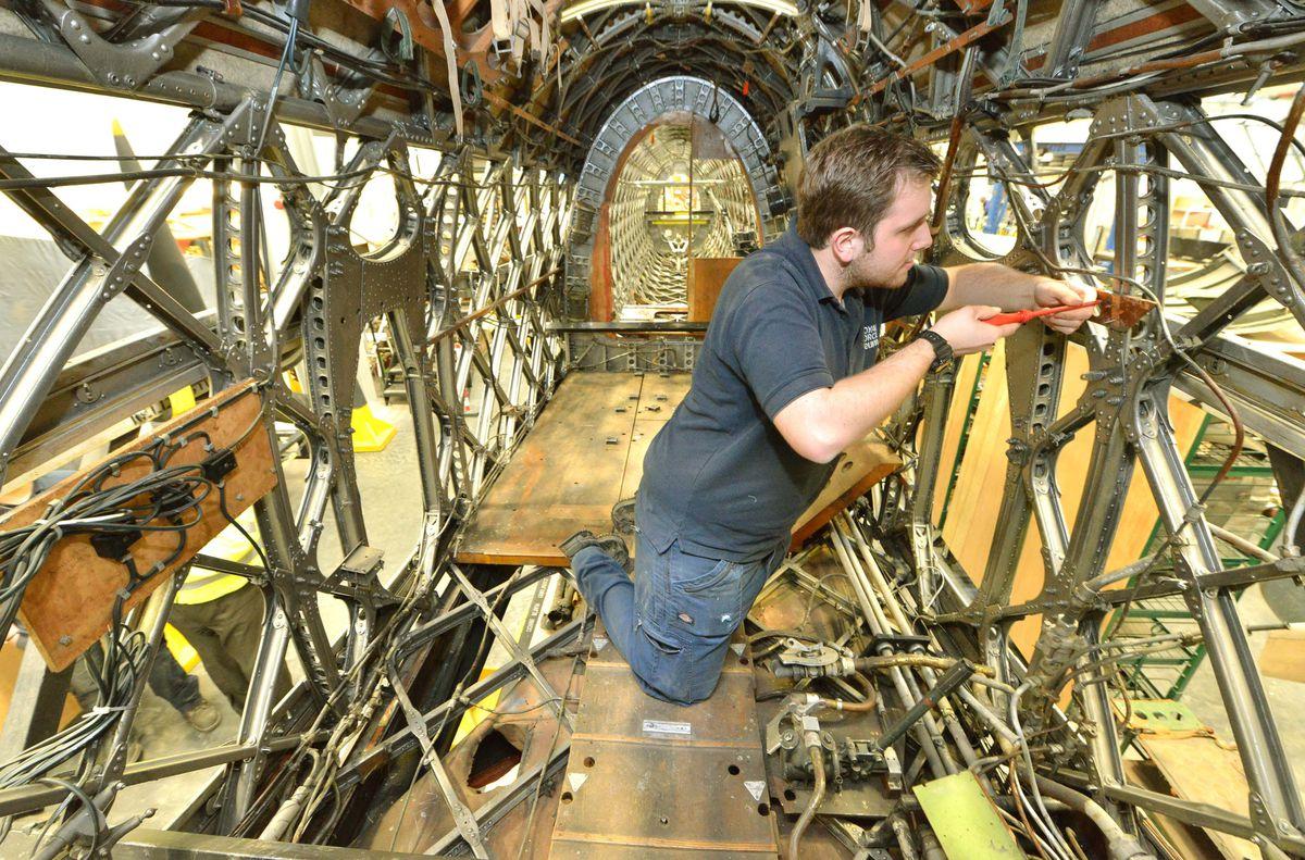 Apprentice Joshua Salt working on the restoration of a Wellington bomber