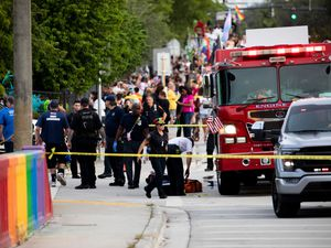 Police and firefighters respond after a truck drove into a crowd of people during The Stonewall Pride Parade and Street Festival in Wilton Manors, Florida