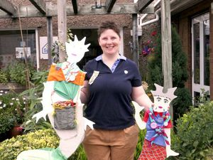 Trainee Guide leader Anna Gallen with the two of the meremaid figures made by Ellesmere Guides and Brownies .