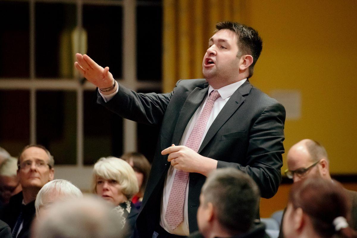 Telford & Wrekin Council leader Shaun Davies tries to speak at the meeting