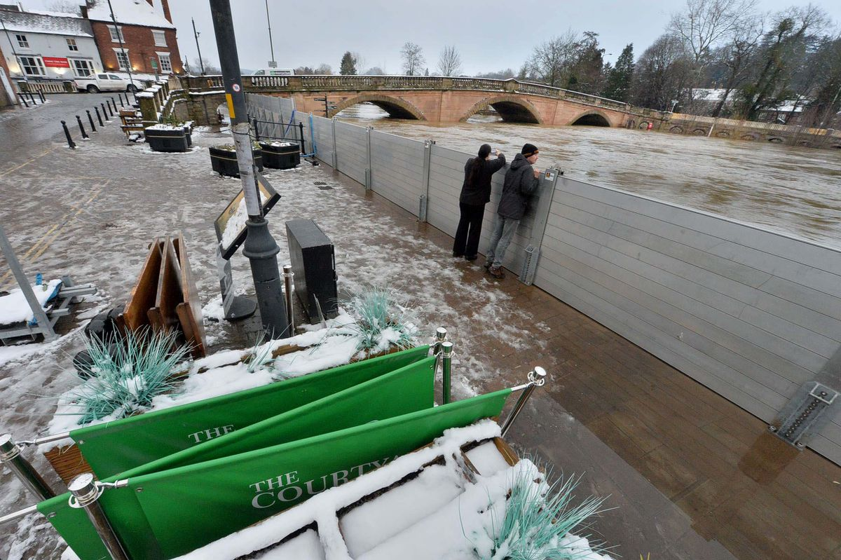 Snow fell next to the flood barriers in Bewdley on Sunday