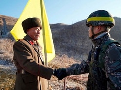 North and South Korean soldiers cross border to check disarmament moves