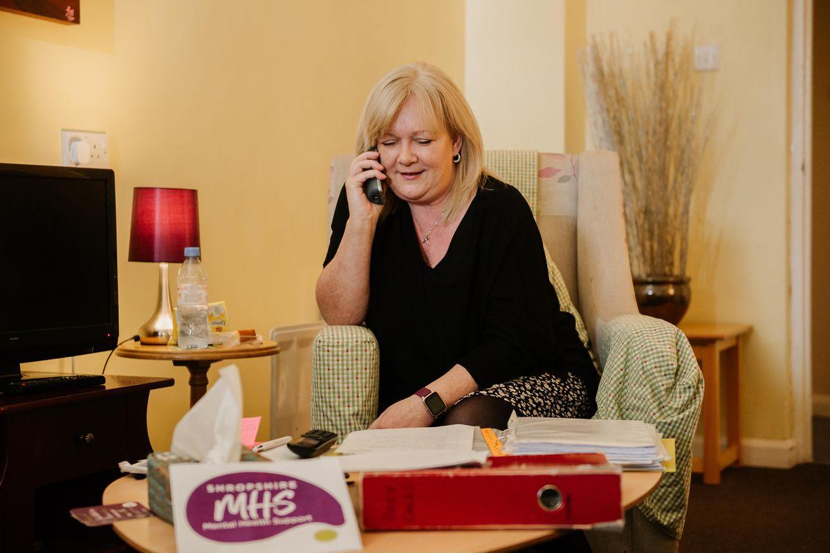 Outreach support worker Karen Griffiths receives a call