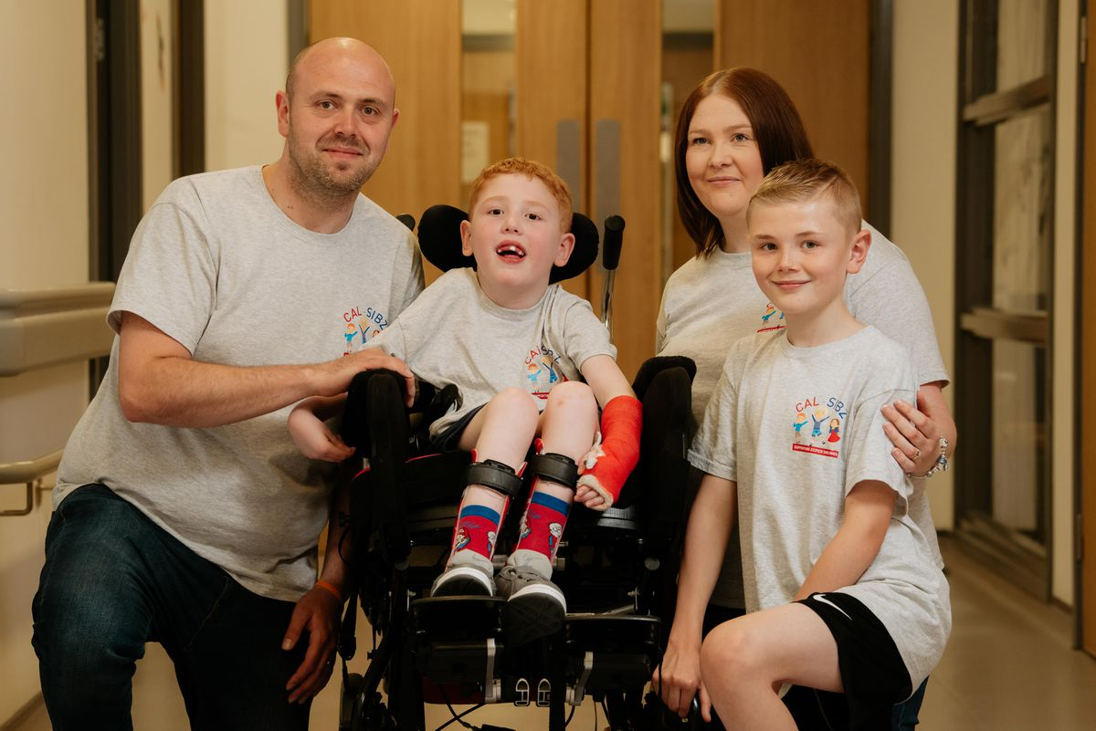 Liam Finazzi, in wheelchair, with father Andrew, mother Kerry and borther Callum