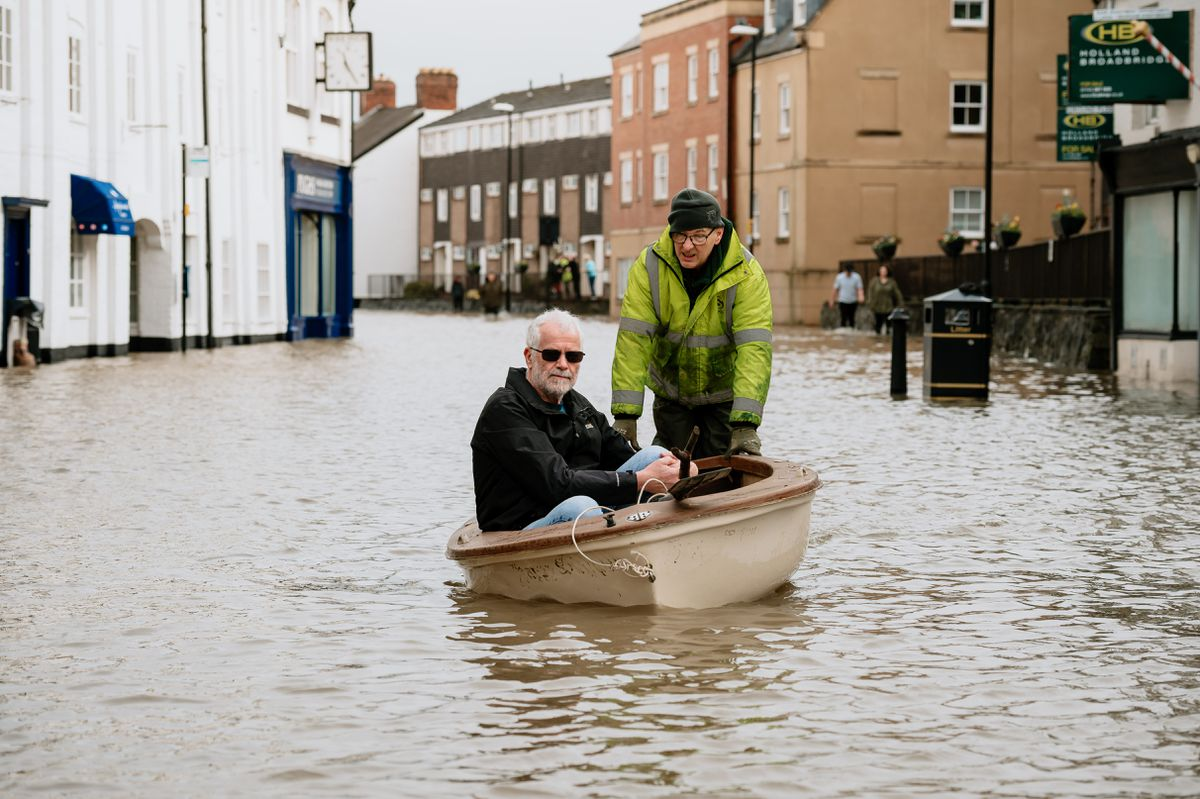Taking to a boat in flooded Coleham, Shrewsbury