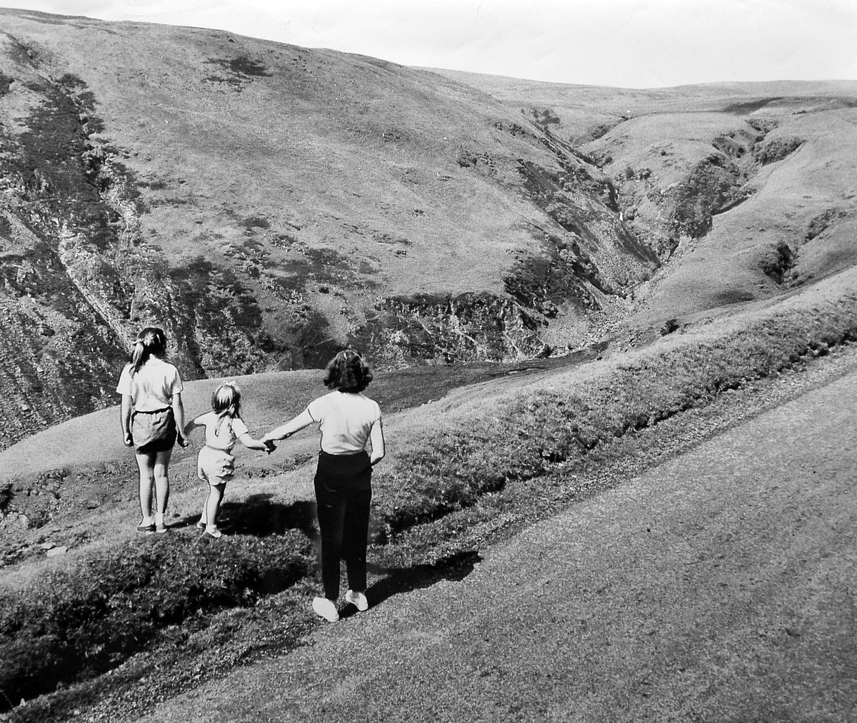 """A view for Salopians heading for a break in Wales. """"A road with a view – into the Tanat Valley"""" was the original caption to this picture from our archives which dates from July 1964. This was taken on the long climb out of Llangynog on the road to Bala. And here's a curious thing – the view is much more spectacular looking the other way."""