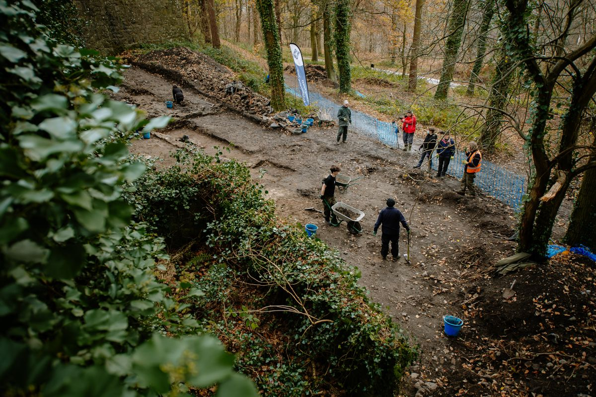 Archaeological dig on the remains of a large wall on the outside of Chirk Castle
