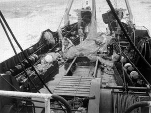 COMMONS Cod/File...File photo dated December 1975 of a scene aboard the deckhands on the Flydea prepare to lower the fishing net into the Norh Sea. Trawlerman who lost their jobs during the Cod Wars with Iceland in the 1970s are to become eligible for compensation payments of up to £20,000, the Government announced today Friday July 28 2000. See PA story COMMONS Cod. PA Photos NB: Available in B&W only