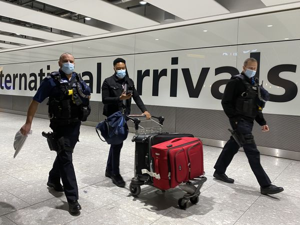 People arrive at Heathrow Airport