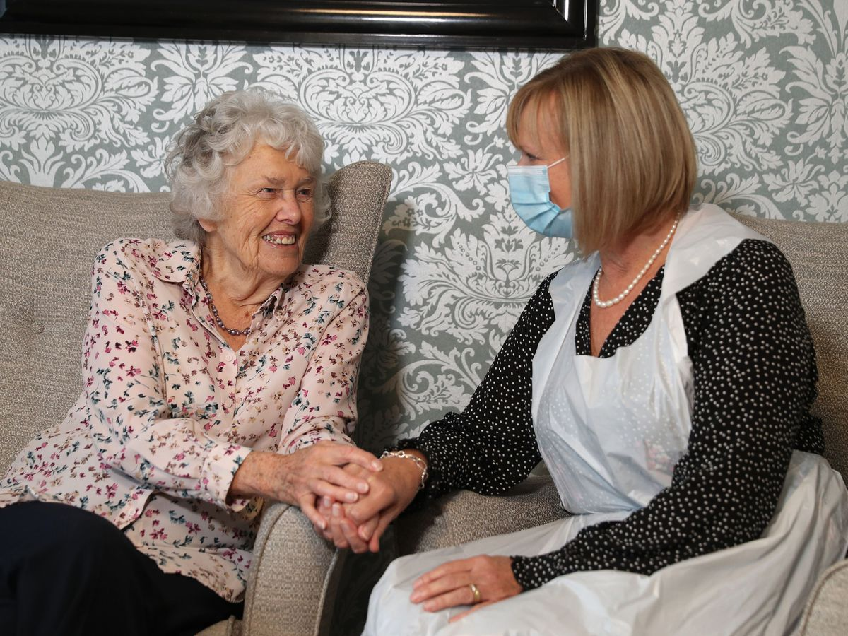 A care home resident is visited by her daughter