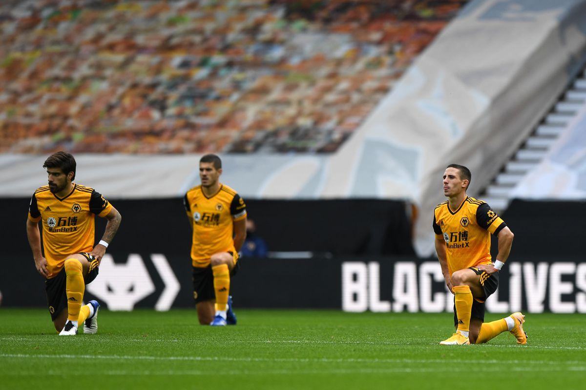 Ruben Neves of Wolverhampton Wanderers and Daniel Podence of Wolverhampton Wanderers take a knee (AMA)