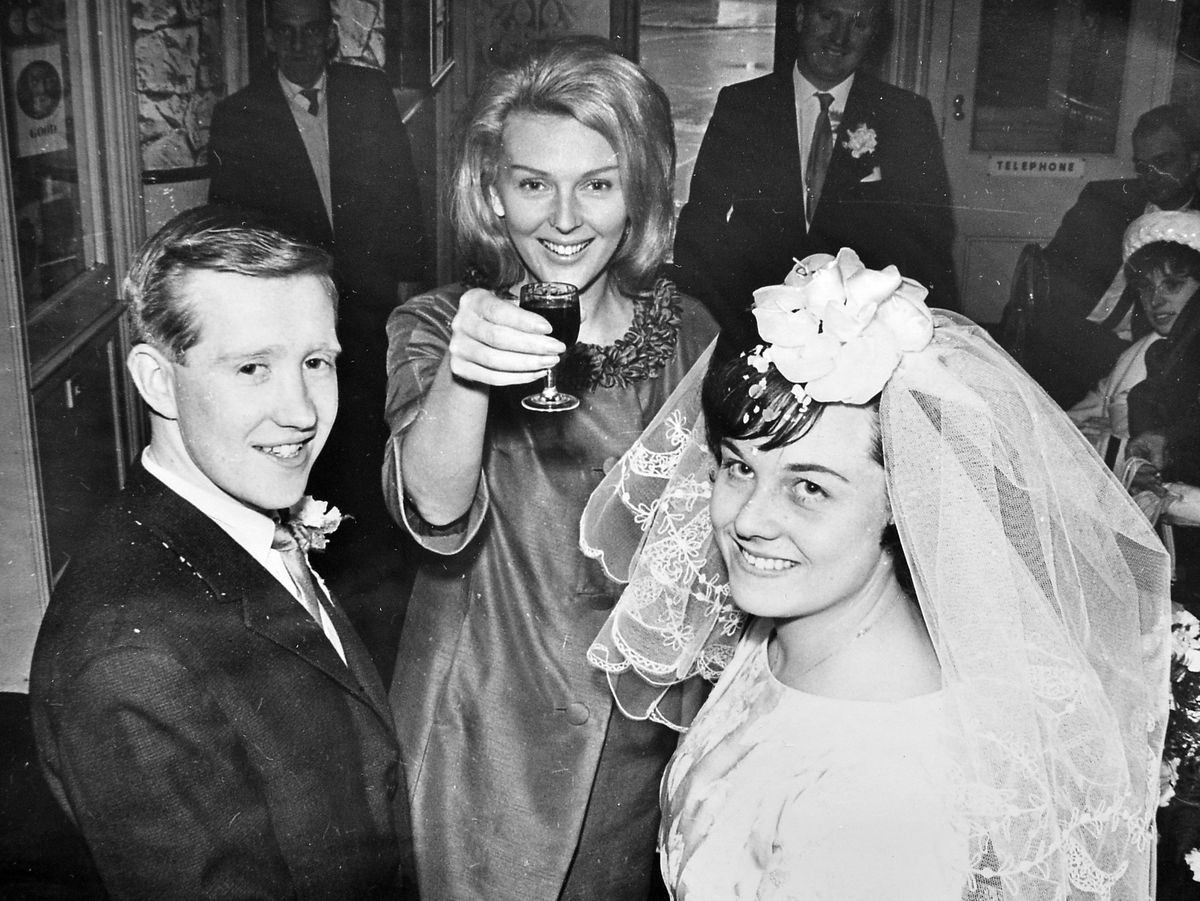 Broseley singer Janie Marden raises a glass to the wedded couple after making the dash to Shropshire for the Hadley marriage in March 1965 of her cousin Diane Garbett and Clifford Biddulph.