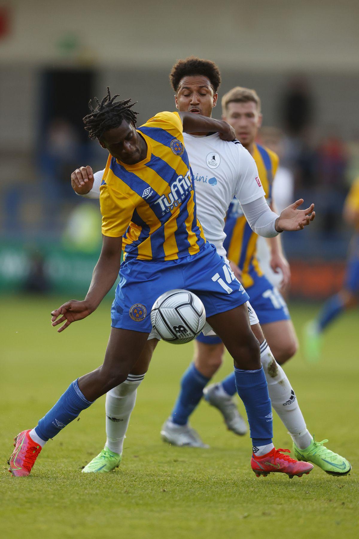 Dom McHale of AFC Telford United and Nathanael Ogbeta of Shrewsbury Town (AMA)