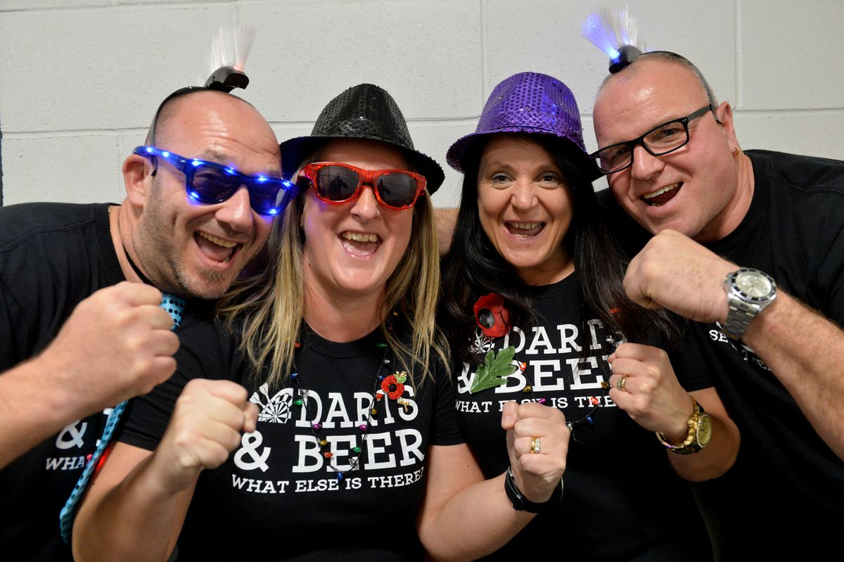 Dandy and Sarah Burden with Donna Briscoe and Shaun Ridding celebrate the return of the Grand Slam of Darts.