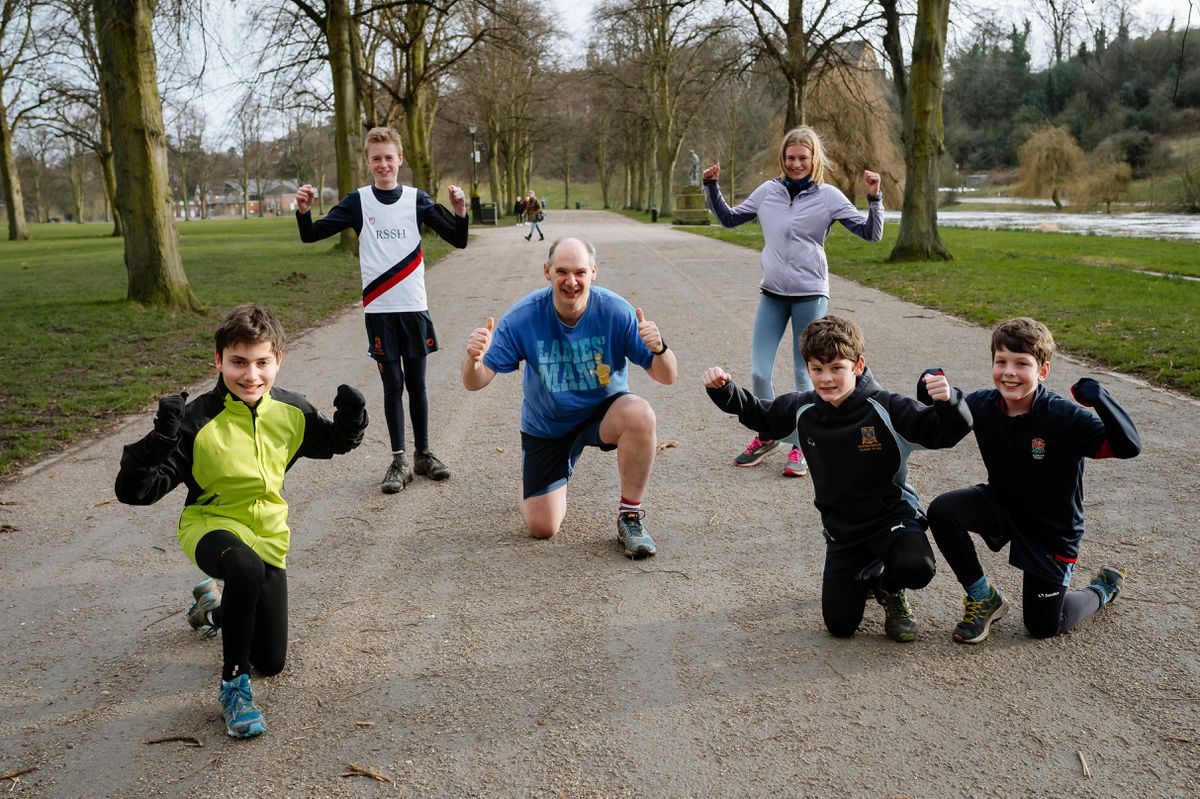 Giles Bell with some of the younger members who have been taking part in the charity running challenge