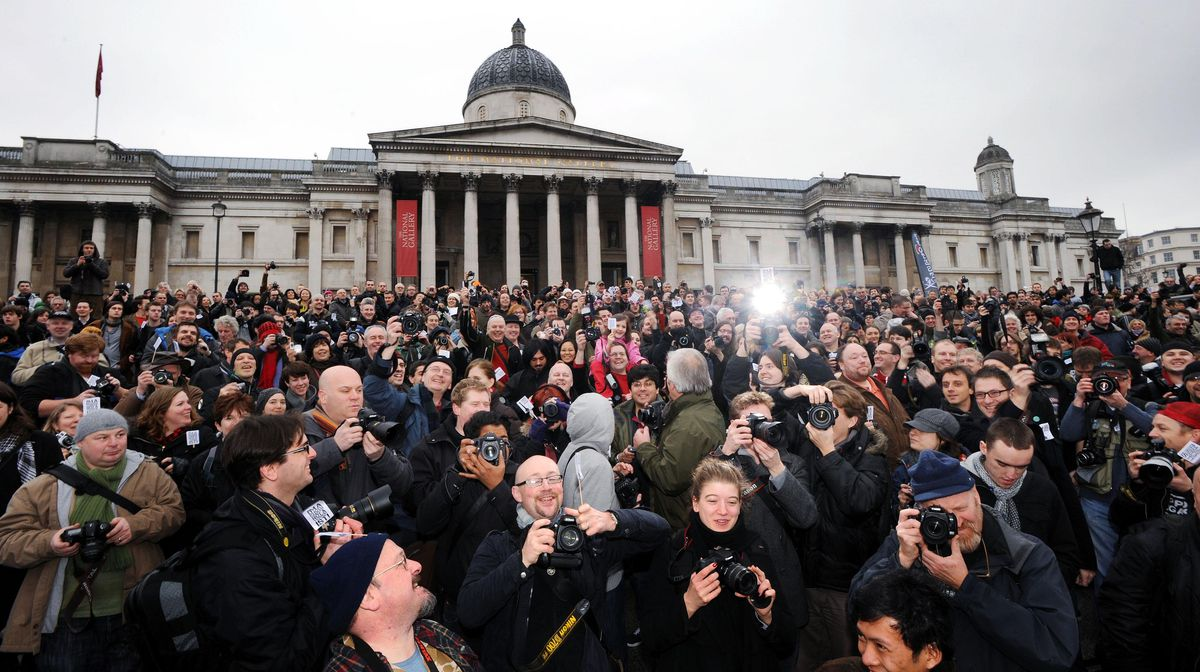 Photographers take pictures in London's Trafalgar Square during a mass gathering