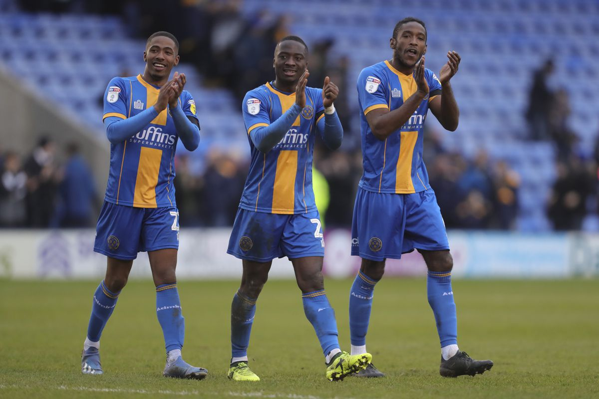 Kayne Ramsay, Daniel Udoh and Omar Beckles of Shrewsbury Town celebrate winning the game at full time (AMA)