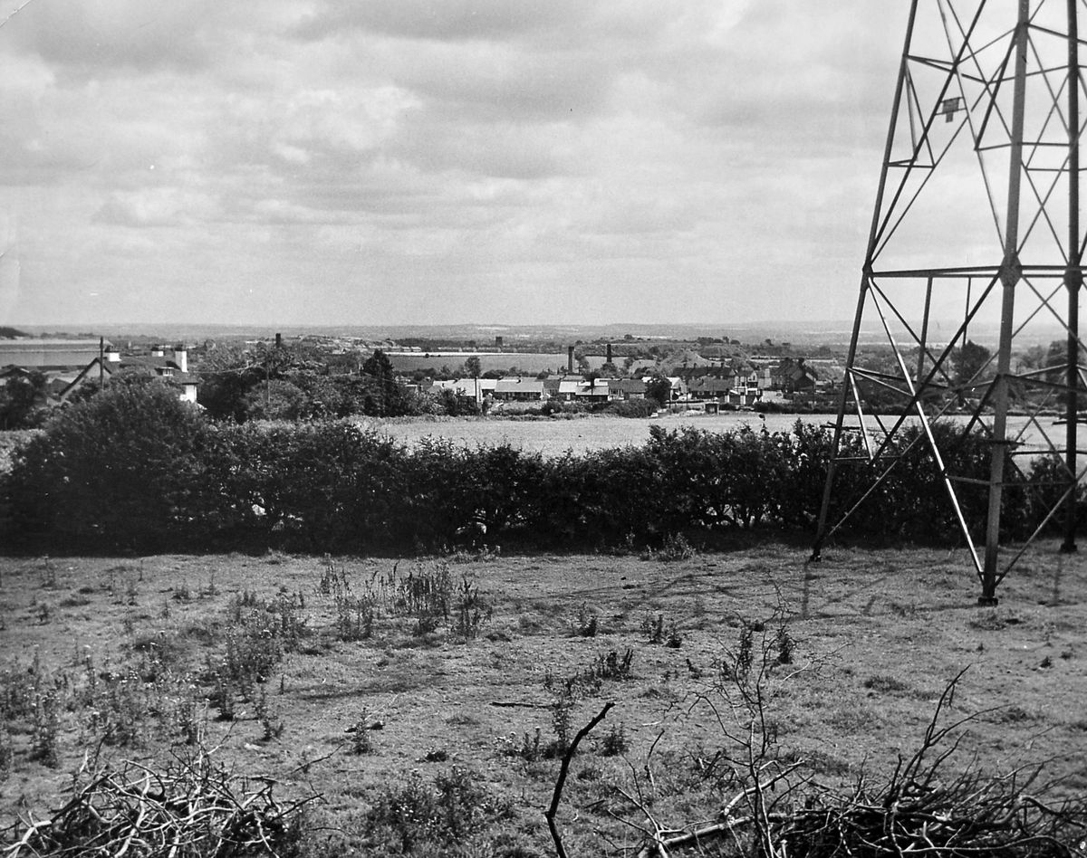 This picture was taken in 1962 or 1963 from the vicinity of Coalmoor Farm, near Little Wenlock, looking in the general direction of Dawley and Horsehay. You can just about make out the tower of Dawley church amid the old pit mounds in the distance.
