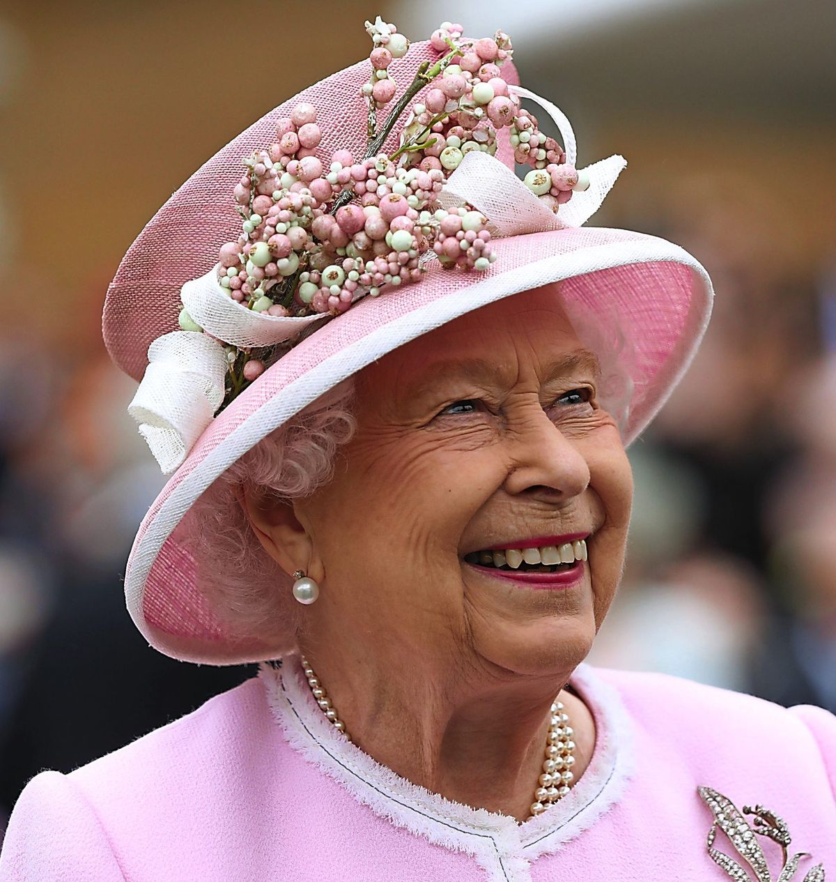 Her Majesty wore her favoured colour of deep pink