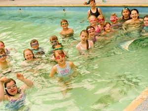 Children took part in a swim with a mermaid event at Ellesmere College swimming pool
