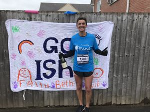 Isha Alsadek completed a marathon on the car park and green by her home in Donnington