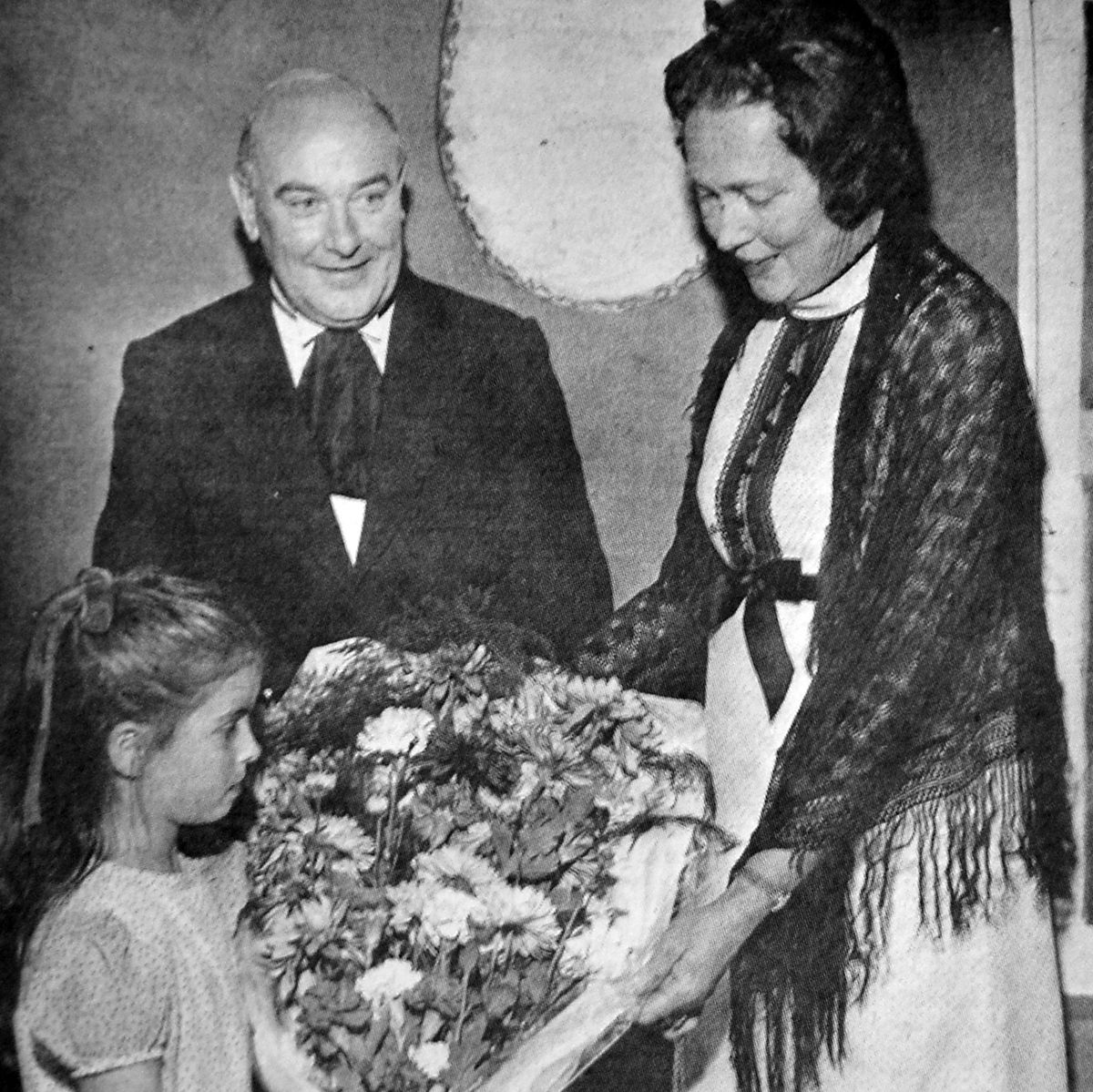 The opening on Thursday, October 7, 1971. Frances Williams presents Councillor Mrs Margaret Shaw with a bouquet on behalf of Wellington Theatre Club. Looking on is Frances' father, Roy, chairman of the club.