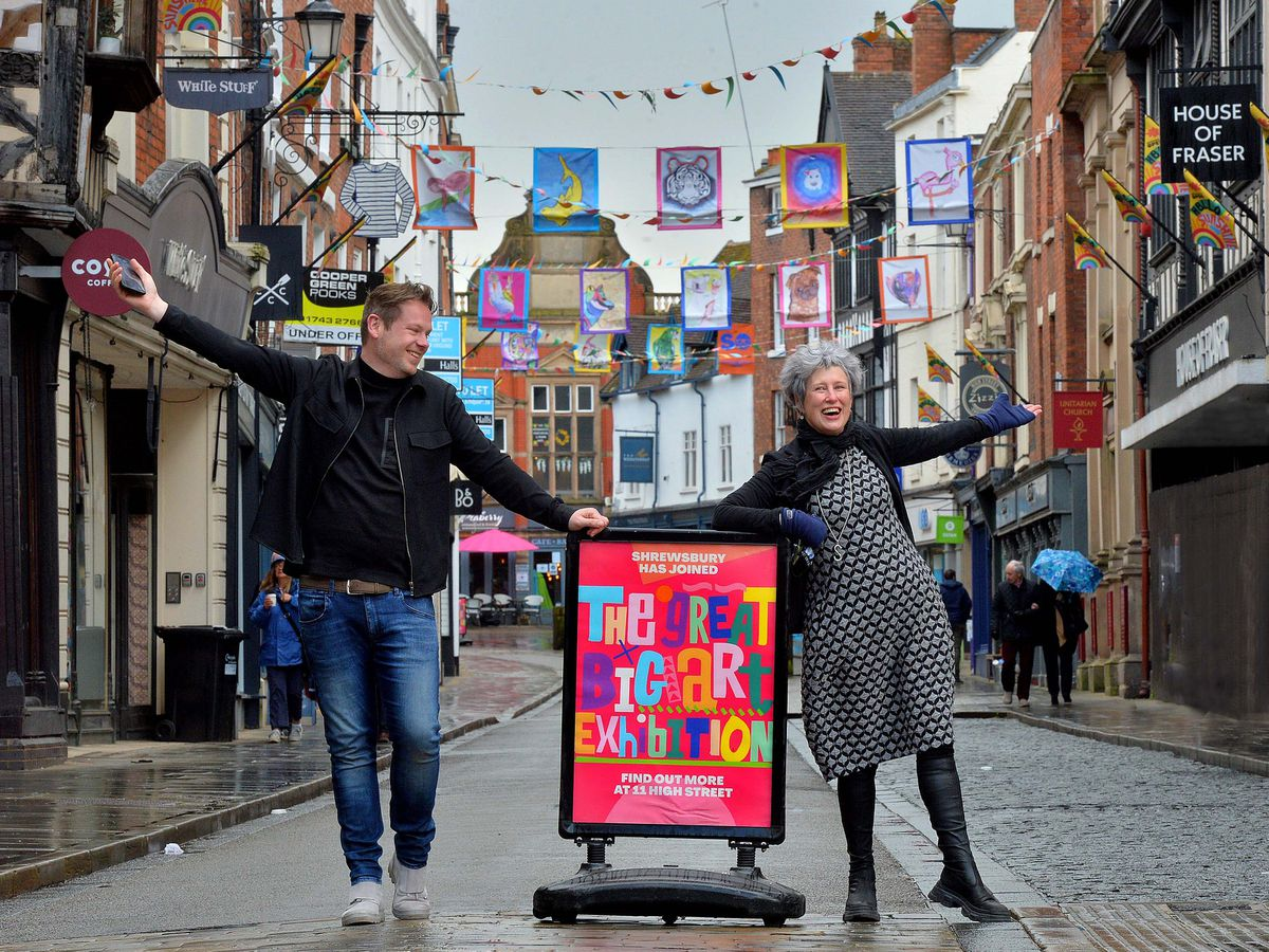 Jonathan Soden from The Soden Collection gallery and Stacey Hill from Oberon in Shrewsbury's High Street, which has bright flags designed by children