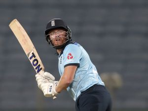 England's Jonny Bairstow bats during the first One Day International cricket match between India and England at Maharashtra Cricket Association Stadium in Pune, India, Tuesday, March 23, 2021. (AP Photo/Rafiq Maqbool).