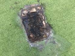 Thoughtless: Bank holiday barbecue melts astroturf cricket pitch at Telford park