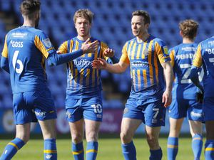 Shaun Whalley of Shrewsbury Town celebrates after scoring a goal to make it 1-0.