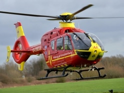 Elderly man seriously injured after becoming trapped under car near Newport