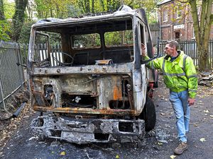Business owner Paul Holloway with the destroyed recovery truck at the site off Holyhead Road in Ketley Bank, Telford